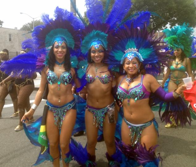 "<p>&#10;&#9;Co-creator Carleen Ramlochansingh &nbsp;(center)&nbsp; is flanked band publicist Anne-Rhea Smith (r.) and masquerader Angela (l.) during the debut of the ""La Rivière"" section of Sesame Fllyers International at the 2013 the West Indian American Day Carnival Parade. Below, ""Phoenix Refined"" founder Kimberly Charles&nbsp; (2<sup>nd</sup>&nbsp; from l.) , bodypainted to portray La Sirene, a Haitian deity, with other members at the 2013 West Indian American Day Carnival Parade. It's new band's &nbsp;second annual foray onto Eastern Parkway&nbsp;</p>&#10;<p>&#10;&#9;<jaredmccallister@gmail.com> </jaredmccallister@gmail.com></p>&#10;"